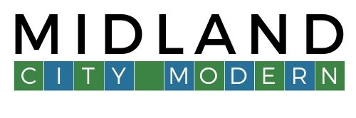 """The Midland City Modern logo in black and white text with alternating blue and green boxes spelling """"City Modern"""""""